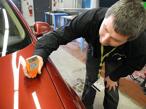 Mark Toljagic Photos Of Darryl Roberts Demonstrating An Electronic Meter On A Vw Jetta For